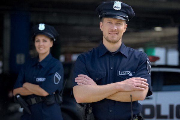 Female and Male police officers.
